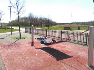 Sunbathing on the way to Dordrecht in hammock at a children's play area