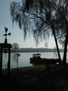 The first ferry of the day across the Maas.