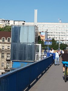 Cycle lift down to the riverside from a busy bridge into Beograd.